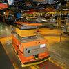 AGV interfacing with overhead conveyor